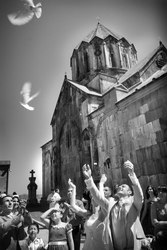 A newly married couple release doves outside Gandazar Monestary.