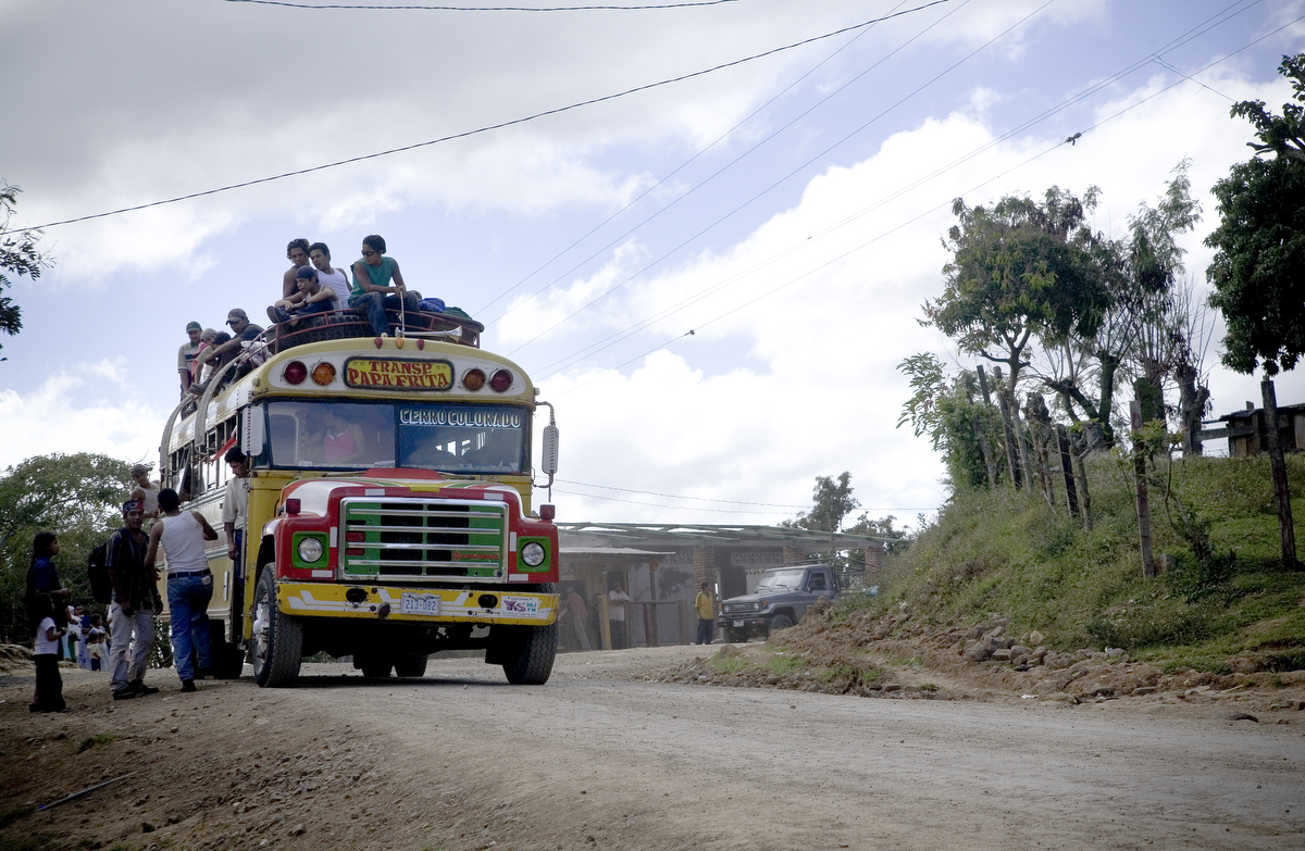 Matagalpa, Nicaragua. An inter-city bus over loaded with passengers in Nicaragua's highlands.