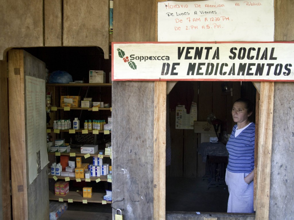 A woman trained to distribute medication at a pharmacy that serves the La Perla community outside Jinotega city waits for customers. The pharmacy is able to offer reduced priced medication due to financial help from SOPPEXCCA, a fair trade cooperative to which some members of La Perla community belong.