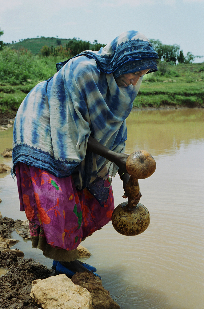 A woman collects drinking water near Harar.